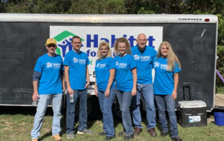 Florida office staff members participate in a Habitat for Humanity project.
