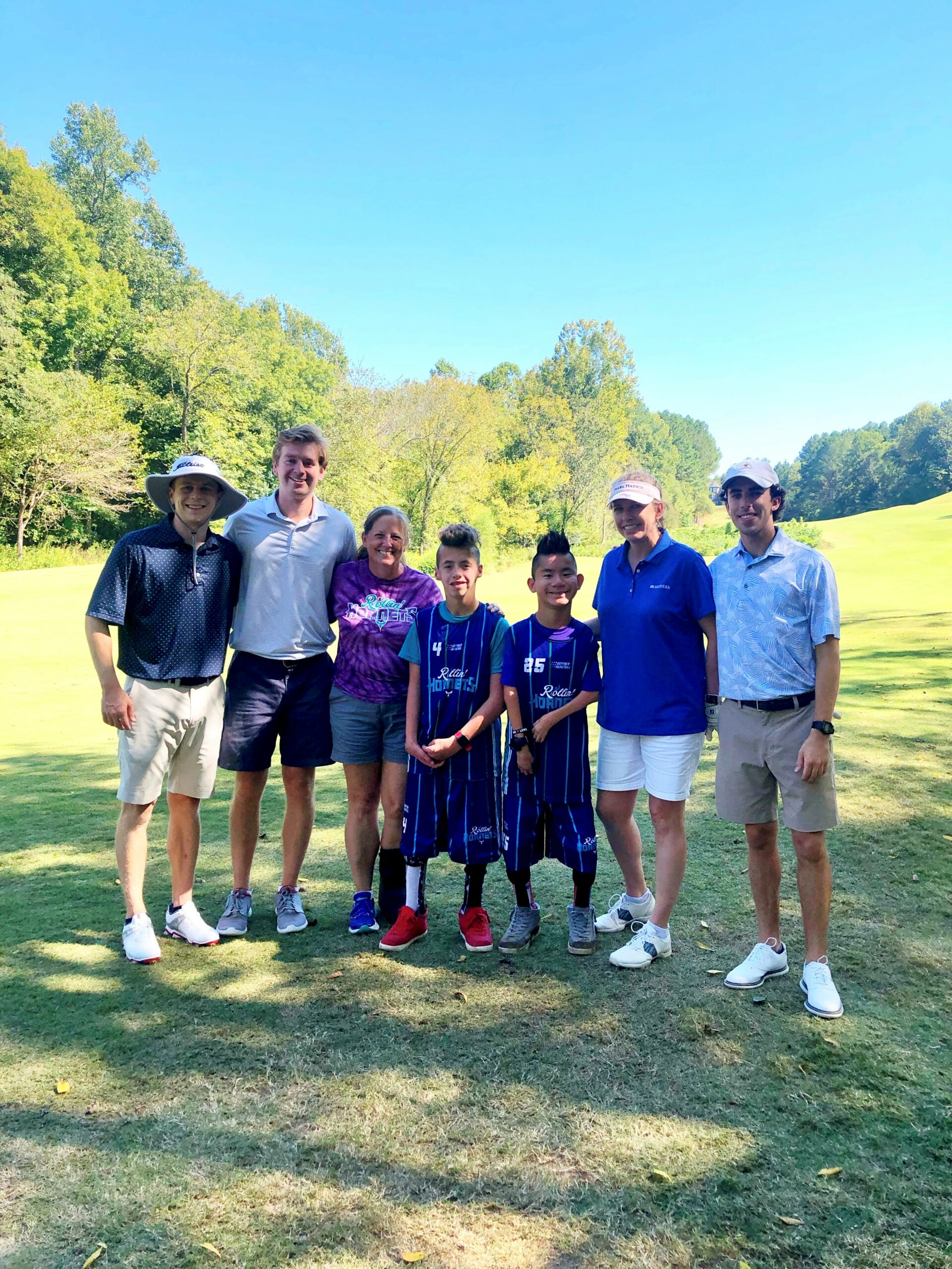 Dawson, Shane, Zach and Erica pose on the green with a couple of players from the Rollin Hornets Team and the event organizer